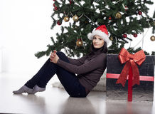 Young woman near new year tree with present Royalty Free Stock Photo