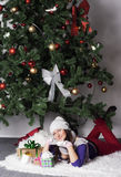 Young woman near new year tree with present Stock Images