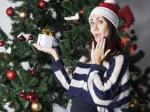 Young woman near new year tree with present Stock Image