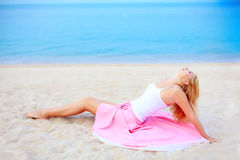 Young woman near the ocean Royalty Free Stock Image