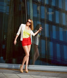 Young woman near office building Royalty Free Stock Photos