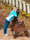 Young woman near an old cannon Stock Images