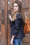 Young woman near old door Stock Photos