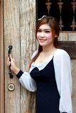 Young  woman near old wooden door Stock Photos
