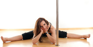 The young woman near a pole Royalty Free Stock Image