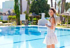 Young woman near the pool Royalty Free Stock Photos