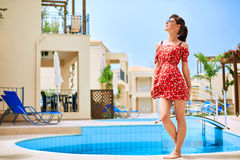 Young woman near the pool Royalty Free Stock Photo