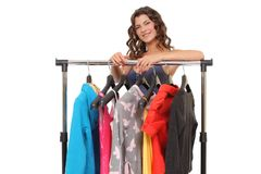 young woman near rack with hangers Royalty Free Stock Image