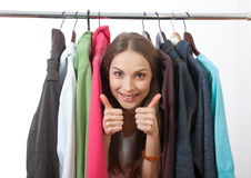 Young woman near rack with hangers Royalty Free Stock Photos