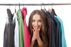 Young woman near rack with hangers Stock Photo