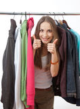 Young woman near rack with hangers Royalty Free Stock Photo