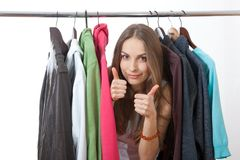 Young woman near rack with hangers Stock Photography