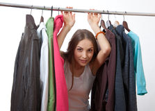 Young woman near rack with hangers Royalty Free Stock Photography