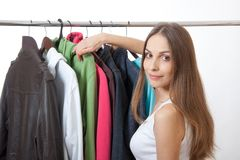 Young woman near rack with hangers Stock Photos