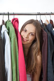 Young woman near rack with hangers Royalty Free Stock Images