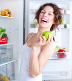 Young Woman near the Refrigerator Stock Photos