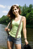 Young woman near the river Royalty Free Stock Photography