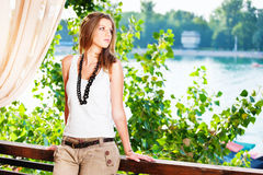 Young woman near river Royalty Free Stock Photography
