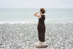 Young woman near the sea Royalty Free Stock Photography