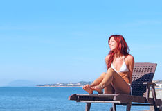 Young woman near sea Royalty Free Stock Photography