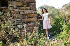 Young woman near a stone wall Stock Photography
