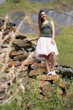 Young woman near a stone wall Stock Image