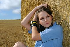 Young woman near the straw bales Stock Photos