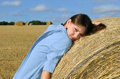 Young woman near the straw bales Royalty Free Stock Photos