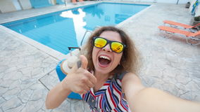 Young woman near a swimming pool stock footage