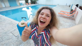 Young woman near a swimming pool stock video footage