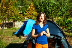 Young woman near the tent Royalty Free Stock Photo