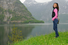 Young woman near to lake. Stock Photography