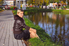 Young woman near to pond Royalty Free Stock Images