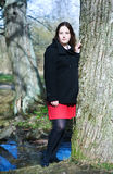 Young woman near the tree. Beautiful young woman near the tree Stock Photography