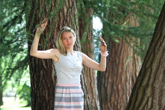Young woman near trees Royalty Free Stock Image