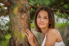Young woman near trunk tree Stock Image