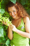 Young woman near vineyard. Royalty Free Stock Images
