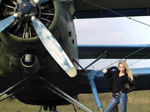 Young woman near vintage airplane Stock Images