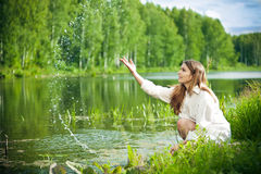 Young woman near water Stock Photo