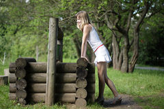 Young woman near a well Stock Images