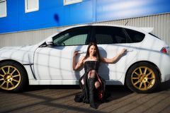 Young woman near white sports car Stock Photography