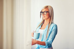 Young woman near window Royalty Free Stock Photography
