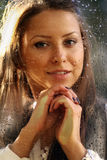Young woman near the window after the rain Royalty Free Stock Image