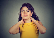 Young woman with neck pain. Young woman with back neck pain royalty free stock photography