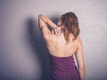 Young woman with neck pain Stock Image