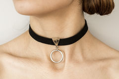 Young woman with necklace. Young woman with black necklace Royalty Free Stock Photos