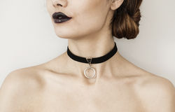 Young woman with necklace. Young woman with black necklace Stock Photography