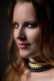 Young woman with necklace. Looking at camera Royalty Free Stock Image