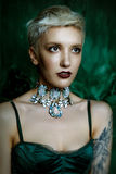 Young woman with necklace. Portrait of gorgeous young woman with necklace Royalty Free Stock Photography