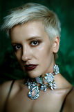 Young woman with necklace. Portrait of gorgeous young woman with necklace Stock Photography